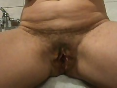 Ever wonder what an old hairy pussy looks like spread wide open?  Well now u don't have to wonder as this hottie shows her loose hanging lips pulled apart for everybody to watch inside her cunt.  If you're into big loose pussy lips, this one is for u as this video is all pussy, all open. The only thing missing is this guy asshole.