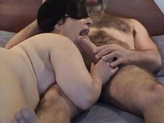 Masked chubby mature wife gives good sucking and licking  to her bushy hubby\'s big dick - short but enjoyable