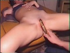 Charming wife acquires her hairless slit filled with golden sex-toy, which her husband pokes into her dripping twat.