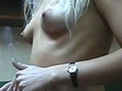 Lecherous blond sweetheart with diminutive sticking mounds walks naked in her room filmed by her boy-friend with dilettante cam in his hands. This guy doesn't like her smoking but really enjoys her sexy undressed body shyly overspread by Fresh Year tree decoration :)