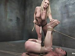 The dominating blonde milf wishes the man's cock but this sweetheart wishes to fuck his wazoo even more! After tieing him with his legs up this sweetheart sucks his cock and plays with his tight hairless butthole before inserting a massive strap on sex tool in it. He groans as the sex tool goes unfathomable in his rectum and has to obey in front of the busty blonde