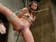 With weights added to her large nipples, sexually excited milf Mia Gold is bound up and has one leg in the air for a more excellent twat domination. Having her face hole gagged, this hottie can only moan. Her mistress sticks a large marital-device in that wet twat of hers and a sex tool on her clit to drive her crazy. Will this hottie cum soon?