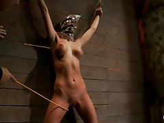 Watch this slut as that honey is tied on the wall and has a bag on her head. She is suffocating slowly and to increase the pleasure of being dominated they punish her sexy body by spanking her on the haunches and belly with a stick. After spanking that honey acquires a vibrator on her cunt and moans with pleasure and pain. She's so sexy with those clamps on her hard nipps and, will they add greater amount weights?