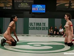 The match is intensive and it appears to be that the referee is looking somewhere else coz things are going wild in the arena. Those bitches don't know the meaning of fair play and a cutie comes in the aid of the other one. Looks like someone will need to surrender