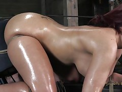 Oiled and tied up our redhead receives a deep mouth fucking from her executor. He is not joking around and gives this slut one hell of a fuck. She sits there tied and with a big rodeo fucking machine beneath her ass. This voluptuous slut needs to acquire all her holes screwed and filled with cum!