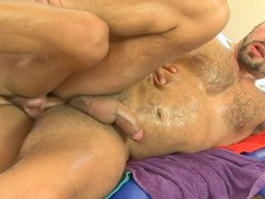 Shaggy guy acquires a lusty anal spooning from masseur