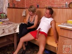 Mature mother and the Son&amp,#039,s friend have a wonderful time on kitchen.