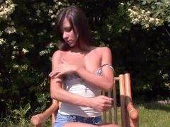 Cutie in jean shorts striptease outdoors